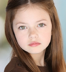 the person playing renemee culen in breaking dawn has been confirmed as Makenzie Foy she is nine years of age and they have confirmed that they will be using CGI to trasform her into younger and older phases and they are going to use other younger and older children as templates for her face to be put onto! know this because my dad is best mates with kellan lutz this is her her hair will most likely be curled is what she کہا (i met her)shes really nice