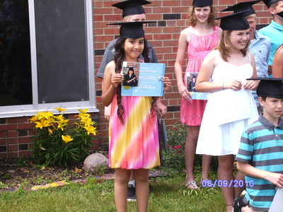 here ya go. i'm the one looking at the camera with my certificate.
