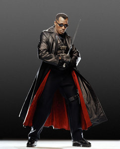 Can they be half-vampire? If so, then Blade. Why? Because he's bada$$!  I also like Dracula's brides from Van Helsing!