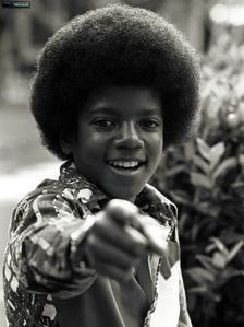 Well, I know he was fine in each of the eras of his life. Though, I am able to pick just one, and that is the [i]Jackson 5 era[/i]. I think he is absolutely fine and gorgeous. He really should be glad I wasn't around then, because he would have a hard time. ;)