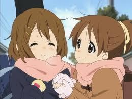 K-On! has a twin main character,Hirasawa Yui and Ui. Try watch it,it's a very great moe musical জীবন্ত and it's even have it's সেকেন্ড season and awards. Now the movie is coming \(^_^)/ The one with the hair untie is the oldest sister and the one with the ponytail is the younger sister,but the weird thing about them is the the little sister is আরো look like the oldest sister cause she's আরো responsible হাঃ হাঃ হাঃ 0_0