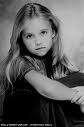 Yes,I'm sure.That girl is Emily Osment. This is at least what i think MDR Does your photo looks a little bit like this?here is Emily Osment: