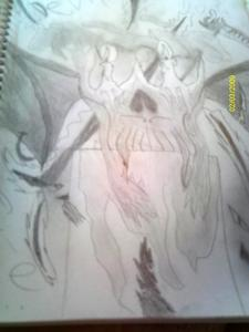 coolness! sinse we r mostrando pictures of skulls and stuff... whatcha think of mine? it says devil don't die and it looks better in the sketch book, but i have 2 keep all the pages in cuz it's my art sketch book, so i took a picture of duh picture! XD