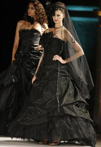 I wouldn't actualy wear a black wedding dress to my wedding but I like this one.