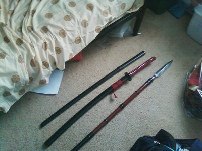 there was a monster but i killed it (yes, this is an actual picha of actual weapons that i actually own, that i took with my new phone that i actually got for krisimasi :D )