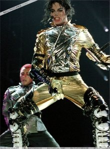 I would just die if my dad gave me tickets to see the HIStory tour! I would FREAK out! I would probably be in the very first row and I might go super crazy and start yelling like hell! Since I get super hyper sometimes, I might even climb onstage with him if I could. What a good time I would have (♥.♥) Too bad I wasn't born at the time of any of his concerts....
