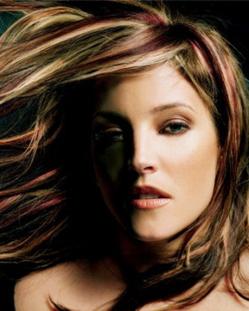 She is gorgeous, but I don't think she can compare to Lisa Marie Presley's beauty.