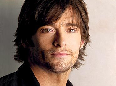 I don't really have one, but the closest I can come is Hugh Jackman. :) He's so hot! :)