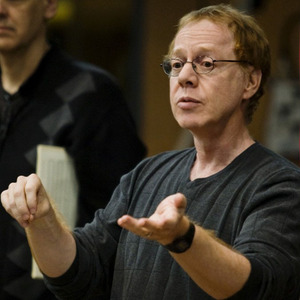 Danny Elfman, he is a musical genius and the God of music. His music is so beautiful and just amazing. I dream of becoming a film composer just like him.
