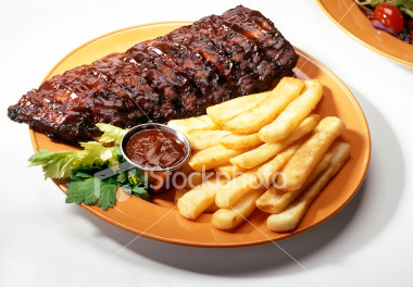 "i luuuuuuuuuuuuuv ribs! they're so yummy and tasty and meaty and saucy! every time (i'm being literal here) i go to a resteraunt (i spelled that wrong) i always get ribs! i like scraping my french fries in the bbq sauce on the ribs! my brother tried to take some and my dad says ""i wouldn't do that, Zachary. if u try to do that you'll either lose a finger au end up with a fork stuck in ur hand.""...now i'm hungry"