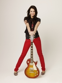 Miley Cyrus Is very Cute And I Luv Her Red Pants.Its a Very Cute Photo Shoot With a Guitar. Hope You Like It AwesomeSelena.