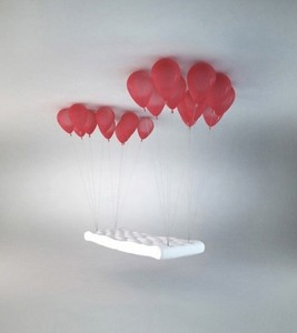 A Chair That Looks Like It Is Held Up da Balloons. Optical Illusion But Real Chair, te Can Buy It!!!