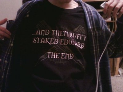 I'm team Dumbledore!! (for those of you who haven't seen A Very Potter Sequel, you won't understand) But for Twilight...I'm Team Emmett ...Or Team Buffy. (That's my cousin in the picture...and I just realized he's in my gramma's house...anyways...I WANT THAT SHIRT!!!!!!!!!!!!!!!!!!)