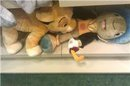 Jimany and Simba... tsk tsk I found this at the Disney store, my friend took a picture of it and sent it to me and i sent it to my email and it came out all small :I sorry though,