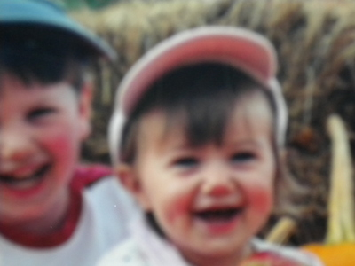 This is what my mom says: I was very smiley and happy, & of course cute. I have pictures of myself picking apples. I was OBSESSED with Tinker Bell, and I have no idea why. Here's a picture of my brother & I when I was only 3 ♥