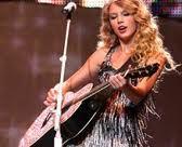 Taylor Swift!!!! <333 Luv her! I also love... 1.Lady GaGa 2. Kesha 3. Katy Perry 4. Selena Gomez etc. :)