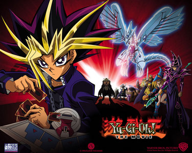 Yu-Gi-Oh? They aren't cute but they do turn into big monsters from cards, if that's what u want. If u do remember it related to cards, maybe it's Card Captor(: