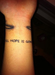 For now i want tattoo like this but not with these things above the words: