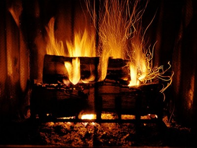 snuggling سے طرف کی the fire, the best & only good part of winter