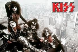I've been a Kiss fan since I was 5, my older sister has alot of the CD's and I borrow them:) I'm getting my own so I don't have to listen to her yell about me borrowing hers:)I've always liked Paul best, first only for the star. Then I really liked his voice, it's great! I was always scared of Gene, but I think that's what he was going for with his look. Now I like him too:) I really like the make-up on them. I wish Eric Singer and Tommy Thayer could have picked out there own make-up. But I guess this is what they thought the fans wanted, just my opinion though:) I have not seen them in concert, buy I hope to before they are all in wheelchairs, coz Gene a dit he'd keep playing even if they had to roll him onto the stage:) I just loved this picture:)