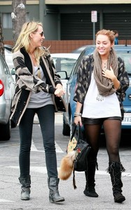 Here it is ,Miley with her mom for a walk: