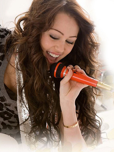 Here is 1 with miley holding a microphone!! hope its ok and te like it!!