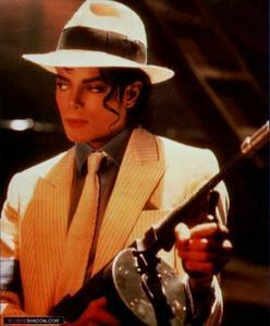 Oh my god, don't even get me started talking about Smooth Criminal!  Beyond love that video.  I love the blending of singing, insterments all blended together.  I believe they call that the wall of sound.  His voice is almost gravely, so sexy!