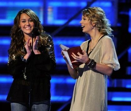 1. Miley with Selena http://1.bp.blogspot.com/_cy8yYOi5VMk/SsybIYw9zlI/AAAAAAAAAas/C2k2ig6s5Hk/s400/293_gaston_lovato_gomez_cyrus_021309.jpg 2. Miley with Jonas brothers http://images.eonline.com/eol_images/Entire_Site/20080422/425.cyrus.jonasbros.042208.jpg 3. Miley with Taylor