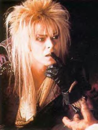 "Jareth from ""Labyrinth"". He's charming, seductive, evil, kind of sneaky-ish and a villian at first. He falls in प्यार with Sarah but has an odd way of दिखा रहा है it since they have a love-hate relationship and Sarah always rejected him. At the end of the movie, Sarah is oblivious of his प्यार of her kind of like Elena to Damon, she just doesn't like him and thinks that he's a bad boy but doesn't know he has actual feelings for her. Also the Elena/Damon dancing scene kind of reminded me of the Sarah/Jareth ballroom scene."