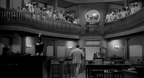 """This is an easy one for me. My all time yêu thích movie is """"To Kill a Mockingbird"""" and when it comes to yêu thích scenes, this is it... Atticus chim hoa mai, chim ưng, finch was defending a black man, Tom Robinson for the crime of rape. A crime he obviously did not commit. Atticus could not overcome the prejudice of the court and Mất tích the trial. The balcony was full of blacks as well as Atticus' children. When Atticus starts to walk out of the courtroom, an old black minister says, """"Miss Jean Louise, stand up,your father's passing."""""""