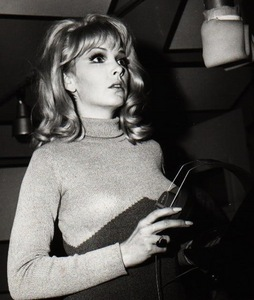 Nancy Sinatra. I admire how she didn't have to dress skimpy অথবা sing songs about sex and drugs to get fame. And even after all that fame, she still looked up to her father, Frank (Yes, Frank Sinatra. That one). I also প্রণয় her fasion sense.