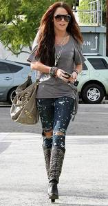 Here!! 1. http://mileycyrushotphoto.com/wp-content/uploads/2010/01/Miley-Cyrus-in-Black-Boots.jpg 2. http://cdn.buzznet.com/media/jjr/headlines/2009/01/miley-cyrus-city-wok.jpg 3.