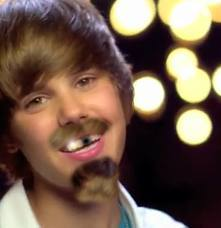 look he is justin beiber. hahah..........when i look this i can,t control my laugh.........haha