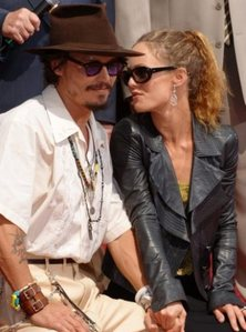 Johnny Depp and Vanessa Paradis!! They're really cute and they care for their kids :)