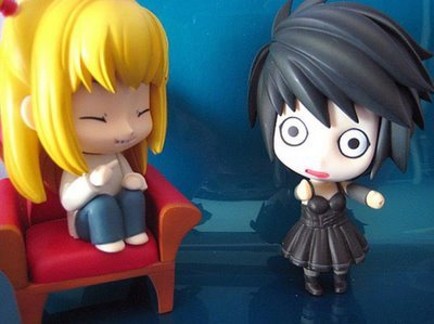 Misa dressed in L's clothes and L dressed in Misa's clothes....xD