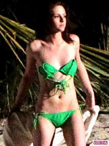 It is because of the honeymoon. K-Stew was caught wearing a bright fluorescentgreen bikini with the straps tied up and it actully stuck to her so in the movie it will appear that she is topless.