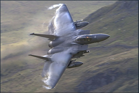 This will blow ya mind... or not. Anyway. It looks pretty damn awesome to me. A F-15 Eagle breaking the soundbarrier.