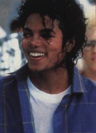 the sexiest part of michael jackson is his lips,his eyes,his curly hair,his body,his voice, and his crotch!