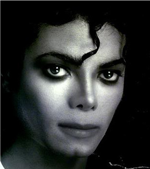 Yes it's photoshopped.. and it's AWFUL!! I amor only Michael's natural black hair..