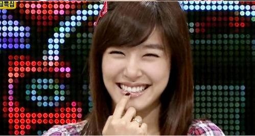 it's TIFFANY.. she has a CUTEE EYE SMILE...