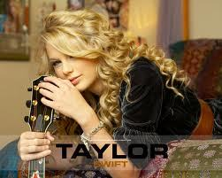 TAYLOR SWIFT!!!!!!! I ADORE HER