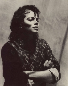 i'm home,sitting on the sofa and chating with one friend on fb and download mj photos from fanpop :)