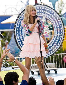 """It's from """"Hannah Montana The Movie"""" She was at """"Lily's birthday party"""" She was গান গাওয়া """"Let's get crazy"""" :p"""
