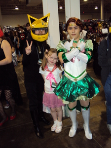 Well, there's me in my Celty ヘルメット and my baby cousin as a make-shift, last 分 Kirimi Nekozawa from Ouran (I personally think it looked pretty good) Anyway, she wanted a pic with one of the sailor moon charas so I bothered this guy for a picture~ --Anime North 2011