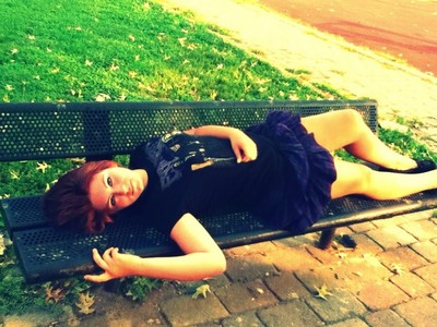 This is me, laying on a bench, at the park. :)