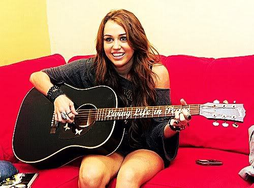 Post pic of Miley Cyrus with guitar.