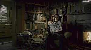 What does Bellatrix pick up off the mantle piece when she visits Severus in Spinners End everytime i watch i get intrigued and i just love his little speech he gives her any help? x x