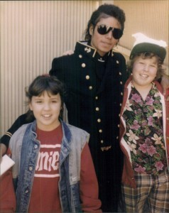 This is Michael from 1985 when he was 27(my age অথবা about that age) with the cast from the Goonies!