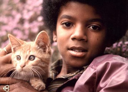 what about cats?? there was some picture of him holding this orange cat...I don't know..