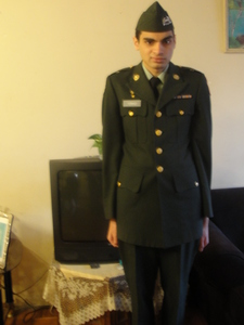 ok yeah that's me i am in my uniform i was in the army jrotc program for my high school my rank at the time was sergeant(sgt)and i was in delta company 4th platoon let 2. the jrotc thought me about first aid what to do when some one get's an cold weather injury's and about heatstroke it also thought me about broken bone's and fractures and about chemical burn's.